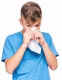 Muchacho adolescente enfermo con gripe Foto de archivo