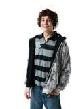 Muchacho adolescente feliz con los auriculares Fotos de archivo libres de regalías