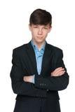 Muchacho adolescente hermoso en un traje negro Imágenes de archivo libres de regalías