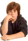 Muchacho adolescente joven aburrido Fotos de archivo