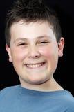Muchacho adolescente joven feliz Imagen de archivo libre de regalías