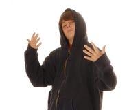 Muchacho adolescente que gesticula a la lucha Imagen de archivo libre de regalías
