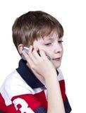 Muchacho adolescente que habla en el teléfono celular Fotografía de archivo