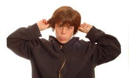 Muchacho adolescente que hace la cara divertida Foto de archivo