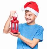 Muchacho adolescente que lleva el sombrero de Santa Claus Fotografía de archivo libre de regalías