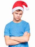 Muchacho adolescente que lleva el sombrero de Santa Claus Foto de archivo