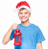 Muchacho adolescente que lleva el sombrero de Santa Claus Imagen de archivo libre de regalías