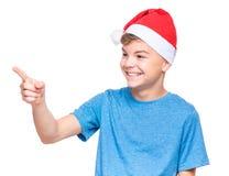 Muchacho adolescente que lleva el sombrero de Santa Claus Imágenes de archivo libres de regalías
