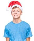 Muchacho adolescente que lleva el sombrero de Santa Claus Fotos de archivo libres de regalías