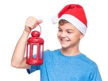 Muchacho adolescente que lleva el sombrero de Santa Claus Fotos de archivo