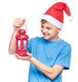 Muchacho adolescente que lleva el sombrero de Santa Claus Imagen de archivo