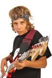Muchacho adolescente que toca la guitarra baja Imágenes de archivo libres de regalías