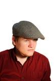 Muchacho adolescente serio que desgasta un casquillo plano Imágenes de archivo libres de regalías