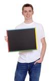 Muchacho adolescente sonriente con la pizarra Imagen de archivo libre de regalías