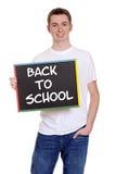 Muchacho adolescente sonriente de nuevo a escuela Imagenes de archivo