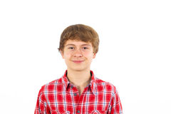 Muchacho adolescente sonriente en estudio Imágenes de archivo libres de regalías