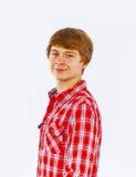 Muchacho adolescente sonriente en estudio Foto de archivo