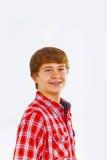 Muchacho adolescente sonriente en estudio Fotos de archivo