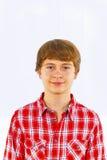 Muchacho adolescente sonriente en estudio Fotografía de archivo