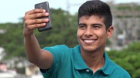 Muchacho adolescente sonriente que toma Selfy Imagen de archivo