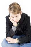 Muchacho adolescente triste caucásico sonriente Fotografía de archivo libre de regalías