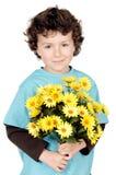 Muchacho adorable con las flores Imágenes de archivo libres de regalías