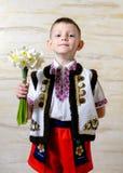 Muchacho adorable que lleva el traje tradicional Imágenes de archivo libres de regalías