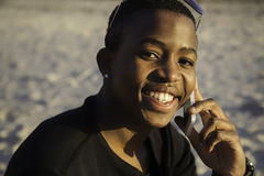 Muchacho africano en el teléfono celular Imágenes de archivo libres de regalías
