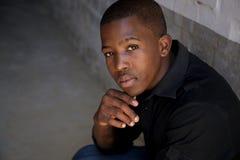 Muchacho africano joven que mira a la cámara Imágenes de archivo libres de regalías