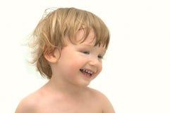 Muchacho alegre en el fondo blanco Fotos de archivo libres de regalías