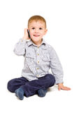 Muchacho alegre que habla en el teléfono Imágenes de archivo libres de regalías