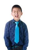 Muchacho asiático con la corbata, aislada en el fondo blanco Fotografía de archivo libre de regalías