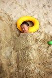Muchacho asiático en la playa Fotografía de archivo