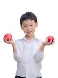 Muchacho asiático feliz con la manzana Imagen de archivo libre de regalías