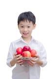 Muchacho asiático feliz con la manzana Imagenes de archivo