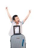 Muchacho asiático feliz con una maleta Foto de archivo libre de regalías