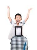 Muchacho asiático feliz con una maleta Fotos de archivo