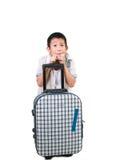 Muchacho asiático feliz con una maleta Foto de archivo