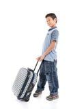 Muchacho asiático feliz con una maleta Imágenes de archivo libres de regalías
