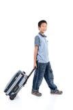 Muchacho asiático feliz con una maleta Fotografía de archivo libre de regalías