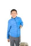 Muchacho asiático feliz que agota la chaqueta azul Imagen de archivo libre de regalías