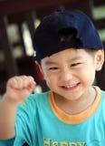 Muchacho asiático feliz en la acción Imagen de archivo libre de regalías