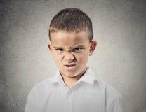 Muchacho asqueado enojado Foto de archivo libre de regalías
