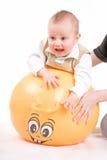 Muchacho asustado en la bola Foto de archivo libre de regalías