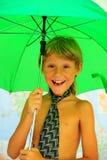 Muchacho bajo el paraguas Fotografía de archivo libre de regalías