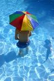 Muchacho bajo el paraguas Foto de archivo libre de regalías