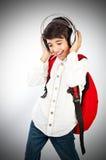 Muchacho bastante adolescente que disfruta de música Imagen de archivo