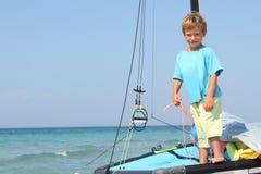 Muchacho a bordo del catamarán del mar Fotos de archivo libres de regalías