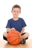 Muchacho con baloncesto Fotos de archivo libres de regalías