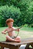 Muchacho con el arqueamiento y la flecha Fotografía de archivo